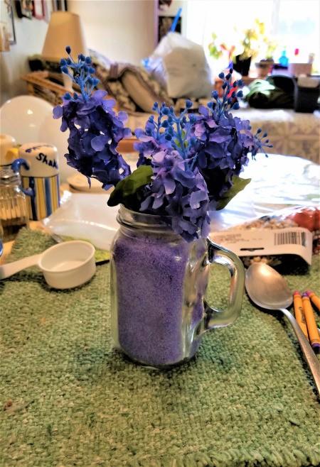 Vase of Many Colors - purple flowers in purple sand