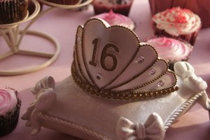 Sweet 16 crown on a pillow shaped cake.