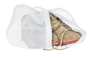 Dirty shoes in a dryer bag.