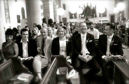 Wedding guests seated in the church.