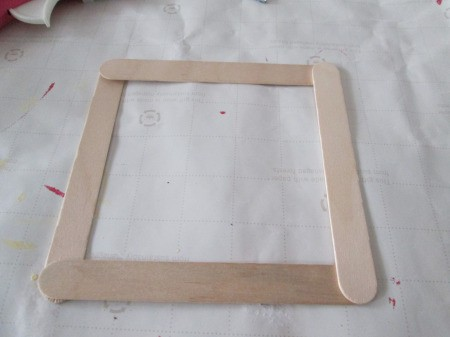 Craft Stick Basket - glue sticks together at the corners overlapping
