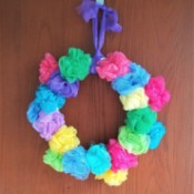 Spring Pouf Wreath - finished wreath hanging on a wall