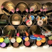 Tin Can Craft Supply Organizer - finished organizer with lids to tilt it back a bit