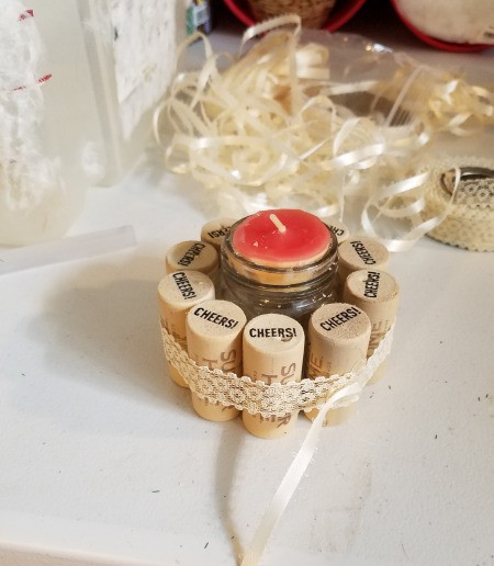 Recycled Cork Thread Dispenser and a Candle Holder - add a length of narrow ribbon over the lace
