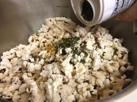 shaking Furikake on Popcorn