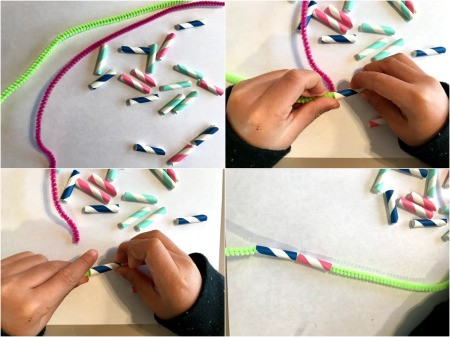 Making a Paper Drinking Straw Snake - child threading straw pieces onto a pipe cleaner
