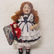 Value of a Marie Osmond Porcelain Doll - red headed doll