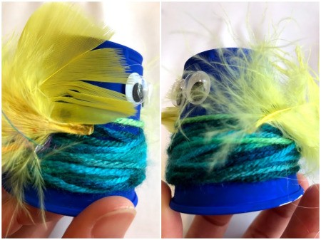 Plastic Cup Pet Bird - side view of blue bird with feathers attached