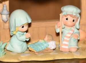 Precious Moments figurines in a nativity.