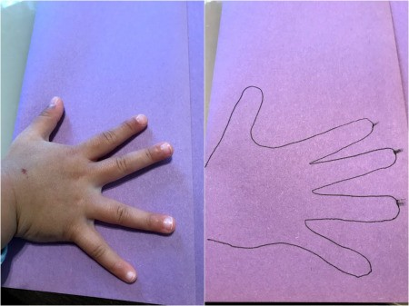 Cute Handprint Butterfly Craft - fold paper in half and trace child's hand at the fold