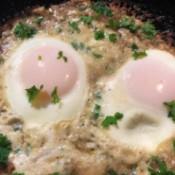 Crispy Parmesan Eggs in pan