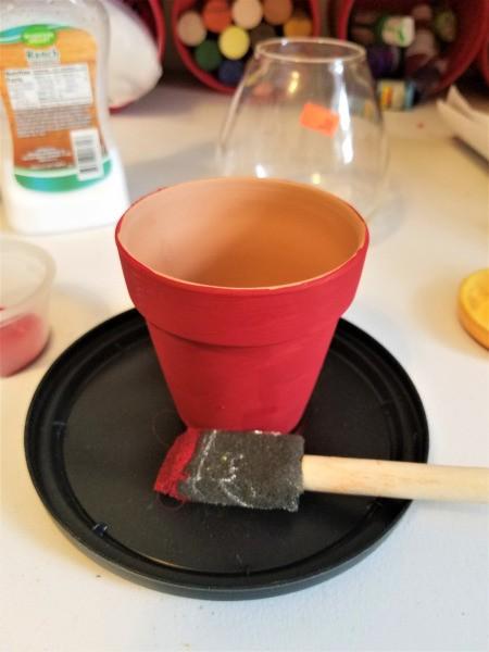 Making a Flower Pot Candy Dish - paint the pot, multiple coats is a good idea