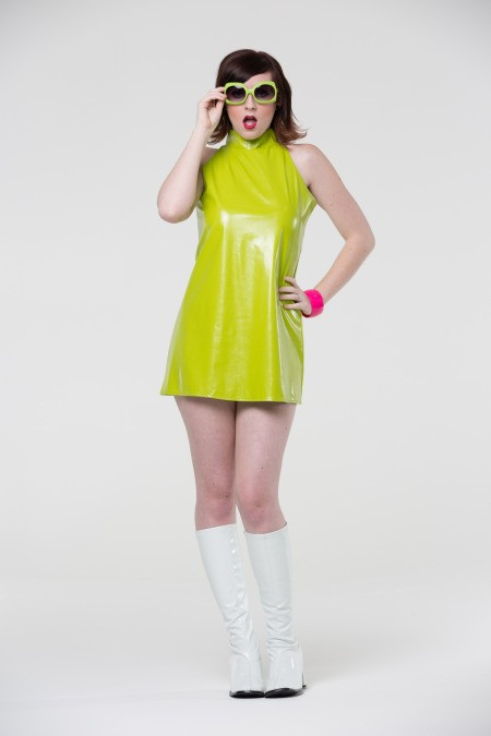 Go-Go Boots - young woman wearing white go go boots and lime green vinyl dress