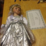 Value of a Heritage Signature Collection Doll - doll wearing a silver dress