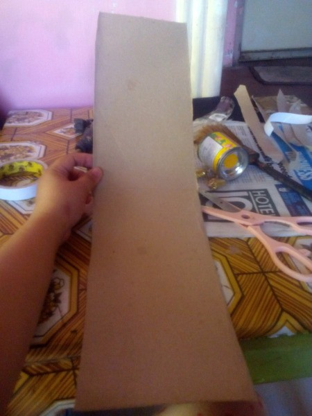 Making an Egyptian Headdress - glue the ends of the two pieces together