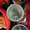 Coffee tubs and other recycled containers being used for organizing tools.