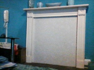 Art Work Ideas for an Unused Fireplace Cover - large plastic fireplace cover