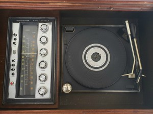 The turntable and radio tuner for a console stereo system.