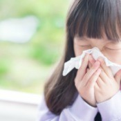 A young girl with a cold or flu.