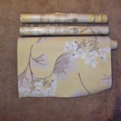 Finding Discontinued Laura Ashley Wallpaper - rolls of wallpaper on carpet