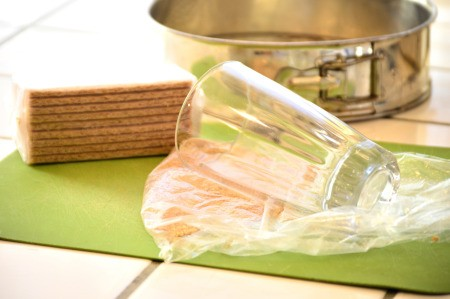 crushing graham crackers with glass