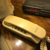 A landline telephone on a nightstand.
