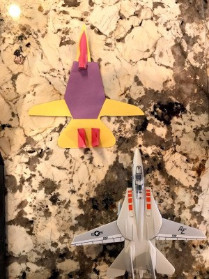Making a Paper Jet  - paper jet next to plastic toy one