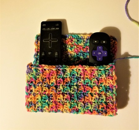 Crocheted Remote Pouch - length is folded back on itself to make the pouch