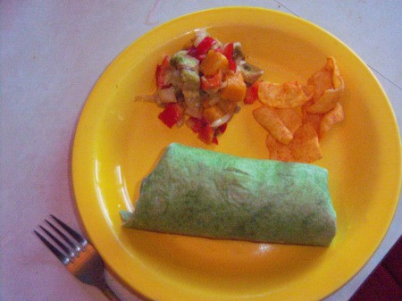 Avocado Mango Salsa on plate with filled tortilla