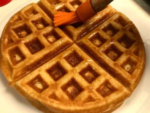 brushing Waffle with butter