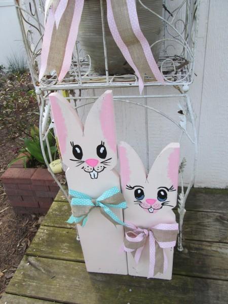 Wooden Bunnies - bunnies on deck of garden shed
