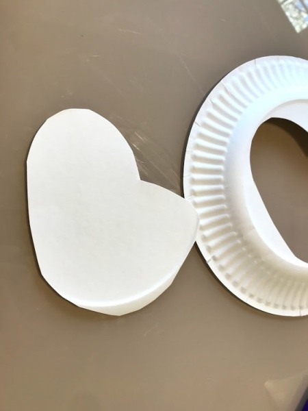 Making a Paper Plate Rainbow - cut out a cloud shape from a paper plate