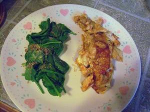 Chicken Enchilada & spinach on plate