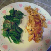 Chicken Enchilada & spinach on plate