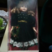 Value of a Memories Classic Collection Porcelain Doll - doll in a box