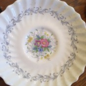 Determining the Value of Old Estate China - scalloped plate with blue floral pattern around the near edge and floral pattern in the center