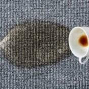 A coffee stain on an upholstered.