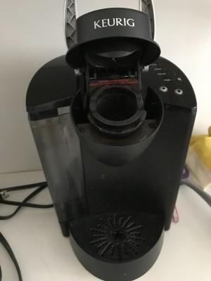 A Keurig coffee maker on a countertop.