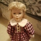 Identifying a Porcelain Doll - doll in plaid dress with a white collar