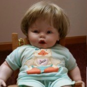 Identifying a Ceramic or Porcelain Doll - baby doll sitting on a chair