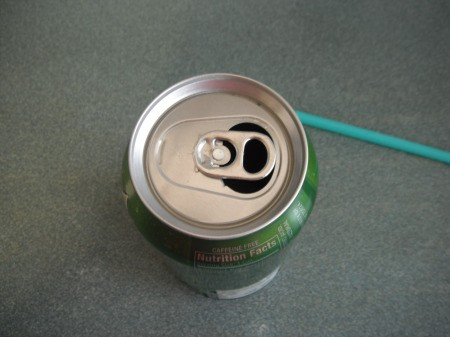 Using a Straw in a Soda Can - turn tab back over the hole