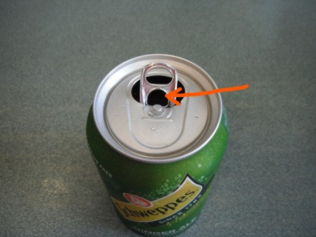 Using a Straw in a Soda Can - do not turn the tab, stick the straw through the hole made when opening the tab