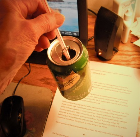 Using a Straw in a Soda Can - once empty the straw is tight enough to lift the can