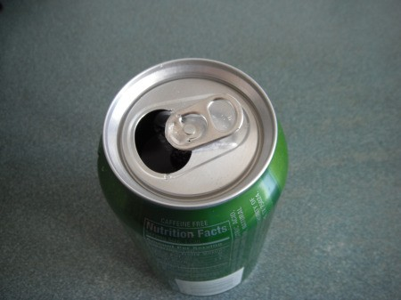 Using a Straw in a Soda Can - press tab flat against top of the can