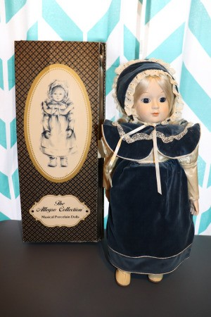 Finding the Value of Vintage Porcelain Dolls - musical doll next to box