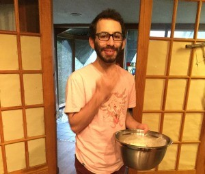 man holding bowl of popcorn