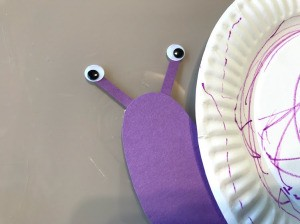 Snail Paper Plate Craft - add eyes