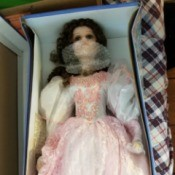 Identifying a Cathay Collection Porcelain Doll - doll wearing a long white dress with pink lace overlay