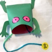 Frog and Fly Catcher Game - finished frog with yard coming out of mouth and fly on the end