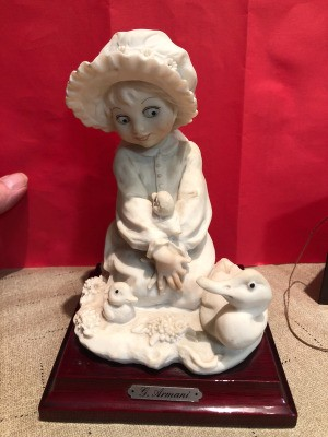 Value of a Guiseppe Armani Capodimonte Figurine - girl wearing a bonnet holding a baby duck